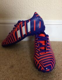 Never worn size 7 Adidas Astro trainers