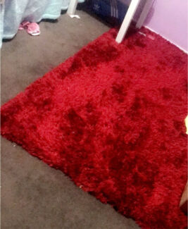 Red fluffy rug