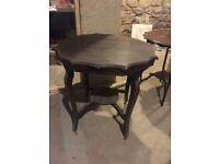 Vintage antique unique dark chocolate brown wooden round table on coasters (H 74 cm x W 74 cm)
