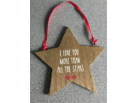 Wooden I love you hanging plaque.