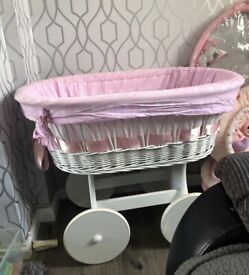 Moses basket and sit up toy