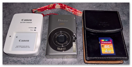 Canon IXY 25iS Digital 10.0 MP Camera, leather case, charger