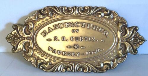 """Antique BRASS ADVERTISING FURNITURE PLAQUE.  S.H. CURTIS WAVERLY, IOWA. 3.5""""x7.5"""