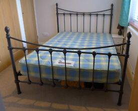 Fantastic condition double dark brown metal frame bed & mattress. Frame RRP £250
