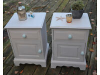 A PAIR of vintage style solid pine bedside cupboards