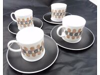 Retro style Susie Cooper coffee cans and saucers.