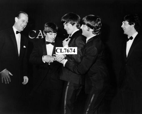 Prince Philip, Duke of Edinburgh with The Beatles at the Carl-Alan Awards Photo