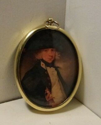 Miniature portrait of midshipman in an oval brass frame