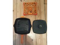 For sale are Le Creuset grill pan, base and panini press.
