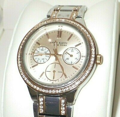 8331b905d33 Anne Klein Women s 12 2297SVRT Crystal Accented Two Tone Multi Function  Watch