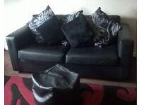 new 2 seater black leather sofa