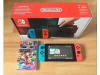 Nintendo Switch Red and Blue with Mario Kart 8 Deluxe