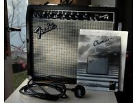 20 year old FENDER Champion 30 amp with original card box and manual.