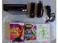 Nintendo Wii complete with Wii Fit Balance Board and Games