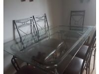 Cast/wrought iron dining room table plus 6 chairs