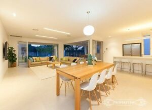 Tasmanian oak dining table with Eames white gloss chairs West End Brisbane South West Preview