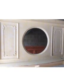 Very large fire surround with a circular bevelled glass mirror between the 2 mantels, it's £399.