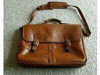 Leather satchel with shoulder strap Unisex item Soft brown leather Buckle and zip compartments.