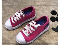 Pink Heeleys size 12