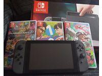 Nintendo Switch (grey) + Mario Kart 8 + 1 2 switch + Splatoon 2