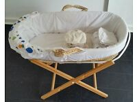 moses basket including stand. in good clean condition. With 10 removable washable mattress covers.