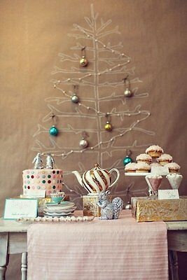 Paper trees have a vintage charm. Credit: stylemepretty.com