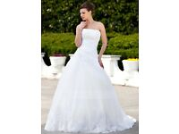 Beautiful white wedding dress new with tags