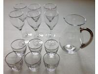 Set of six platinum band glass wine glasses, 6 tumblers and glass jug