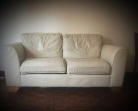 Cream leather two seater sofa