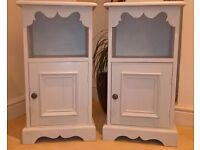 A pair of grey painted bedside cabinets