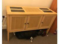 Sideboard, very sturdy, has good storage.