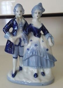PORCELAIN STAFFORDSHIRE COLONIAL COUPLE FIGURINE IN BLUE AND WHITE FROM JAPAN