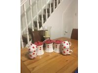 Tea sugar and coffee canisters with matching cups