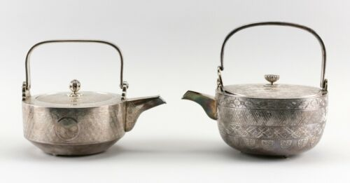 A106 TWO JAPANESE SILVER CHOSHI OR SAKE EWERS Late 19th/Early 20th Century