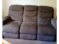 Brown three seater sofa