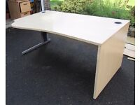 Shaped Office desk - light wood colour top with metal legs, cable management