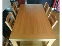 Oak veneer table with six chairs