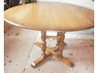 Ercol dropleaf dining table in golden dawn shade.Good condition with a scratch on the surface