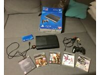 PS3 / PlayStation 3 with 5 games for sale