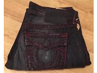Brand new with tags authentic men's True Religion jeans. Ricky style. Waist 33. Thick stitch