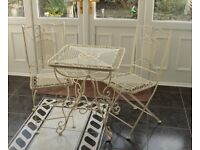 Wrought Iron Patio set. Table and two chairs