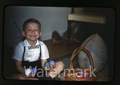 1950s  red border kodachrome Photo slide Young Boy with easter egg candy