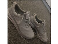 Grey Nike trainers in good condition. Size 5