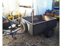 Trailer 5 x 4ft with metal floor, folding rear and ladder rack. Needs new indespension units.