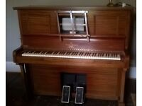 Pianola with large collection of rolls for sale