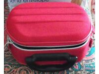 BRIGHT RED VANITY CASE. INNER POCKETS, ELASTIC STRAPS FOR CONTAINERS