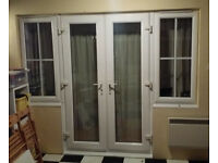 Patio french upvc double glazed white double doors in with frame side windows all with locks.