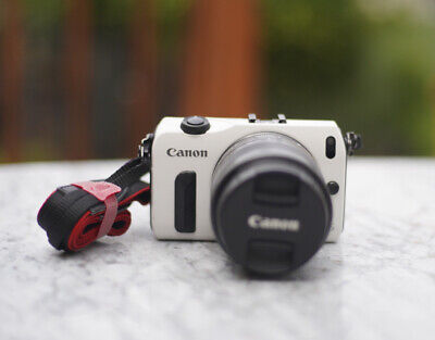 Canon EOS M Mirrorless Camera With Kit Lens, Charger and Canon EF-EFM Adapter