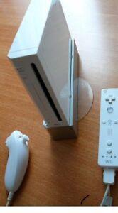 Wii avec toutes les accéssoires plus 9 jeux 150$