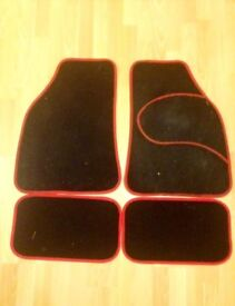 4 Black Car Mats with Red Trim